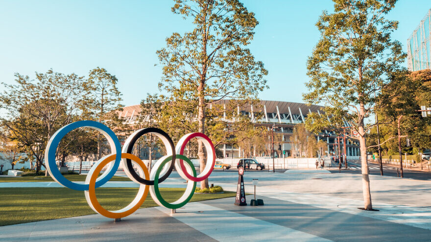 Olympic symbol logo at Japan New National Stadium in Shinjuku. Credit: Urbanscape/Shutterstock.