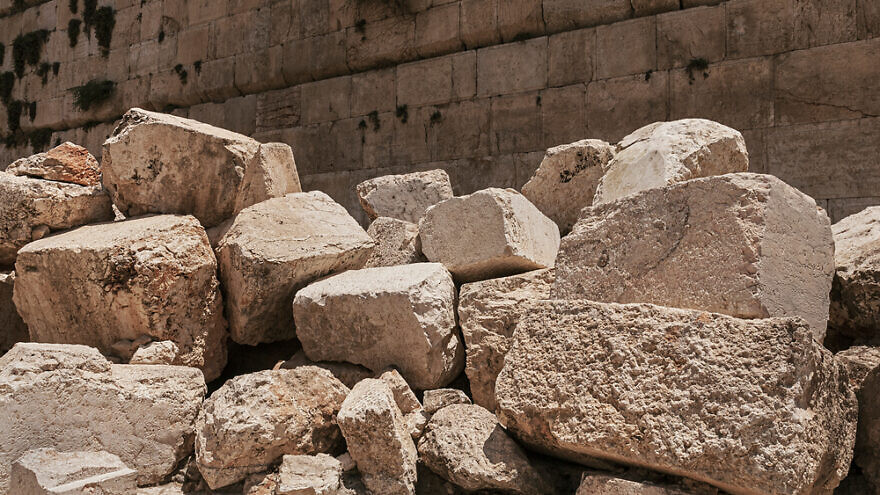 Stones thrown by the Romans from the Second Temple to the street below after the destruction of the temple in 70 C.E. with the Western Wall in the background. Credit: Sarit Richerson/Shutterstock.