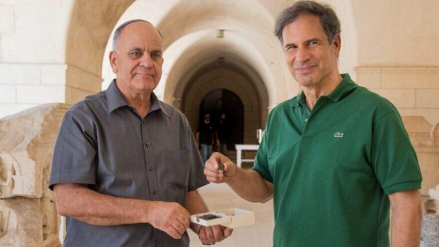 IAA Director Eli Eskosido, left, presents Israeli astronaut Eytan Stibbe with a coin dating to the era of the Bar Kochba Revolt. Photo by Yoli Schwartz/IAA.