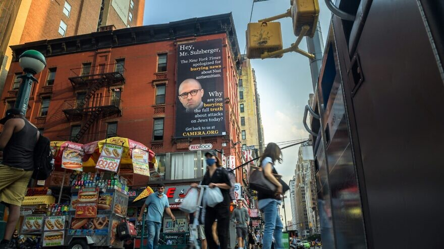 """A billboard with the photo of""""New York Times"""" publisher A.G. Sulzberger has been erected outside the newspaper's headquarters at 620 Eighth Aven. in New York City, August 2021. Credit: CAMERA."""