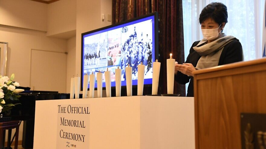 The governor of Tokyo, Yuriko Koike, lights candles in honor of the 11 Israeli athletes murdered at the 1972 Munich Olympics at a memorial ceremony on Aug. 1, 2021. Source: Israel in Japan/Twitter.