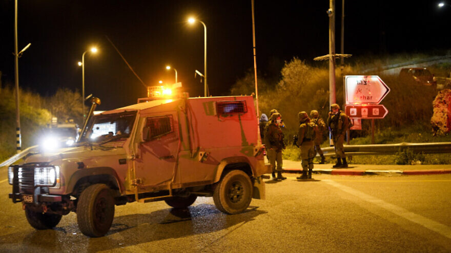 Israeli security forces at the scene where a car hit and killed a woman near the Jewish settlement of Yitzhar, in the Judea and Samaria, Feb. 9, 2021. Photo by Flash90.