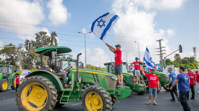 Israeli farmers block junctions all over Israel in protest of the Finance and Agriculture ministries plan to open up the fruit and vegetable market for import, at the Bilu Junction, on July 29, 2021. Photo by Yossi Aloni/Flash90.