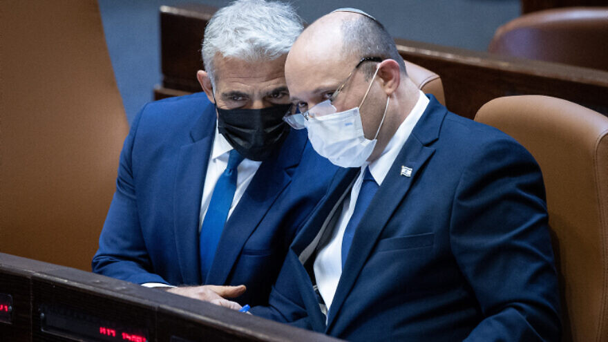 Israeli Foreign Affairs Minister Yair Lapid (left) and Israeli Prime Minister Naftali Bennett during a plenum session in the Knesset on Aug. 2, 2021. Photo by Yonatan Sindel/Flash90.