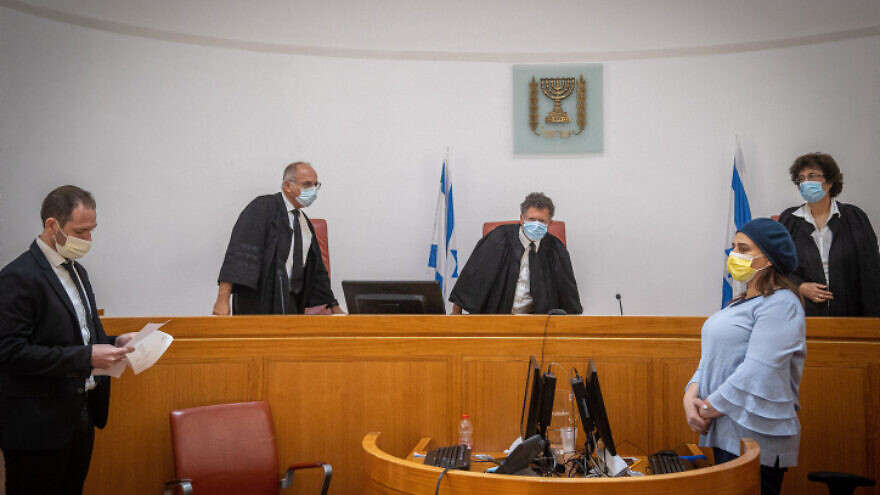 Israeli Supreme Court justice Yitzhak Amit (center) attends a petition regarding the evacuation of Palestinian families from their home in Sheikh Jarrah neighborhood, at the Supreme Court in Jerusalem on Aug. 2, 2021. Photo by Yonatan Sindel/Flash90.