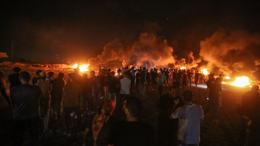 Palestinians riot near the border with Israel, near Gaza City, on Aug. 28, 2021. Photo by Atia Mohammed/Flash90.