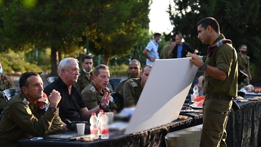 Israeli Defense Minister Benny Gantz discusses regional security with members of the Israel Defense Forces' Northern Command. Aug. 10, 2021. Credit: Ariel Hermoni/Israel Defense Ministry.