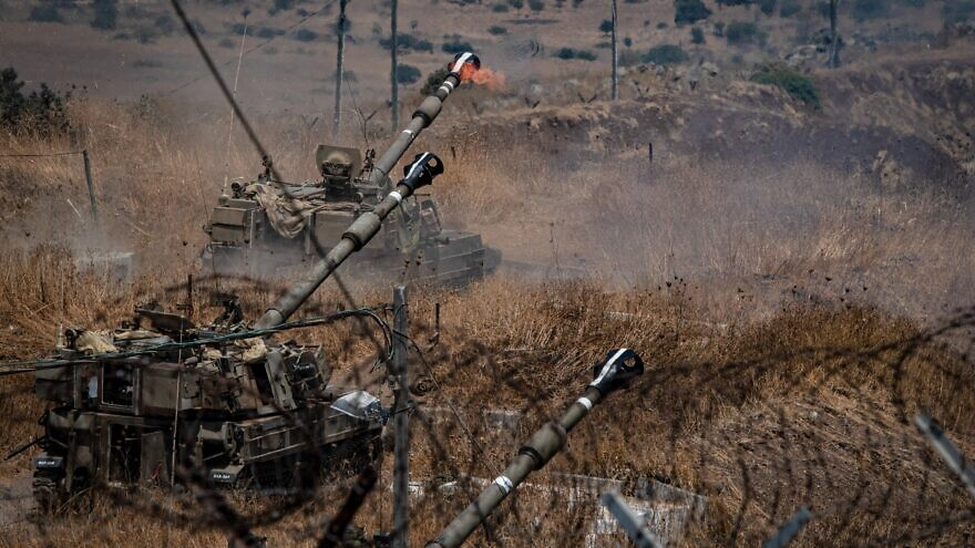 Israel Defense Force Artillery Corps fire into Lebanon near the border with Israel after Hezbollah launches 19 rockets, some at Kiryat Shmona in the north, on Aug. 6, 2021. Photo by Basel Awidat/Flash90.