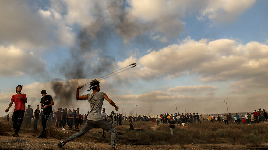 Palestinian rioters clash with Israeli forces during a protest at the Israel-Gaza border, east of Gaza City, on Aug. 21, 2021. Photo by Abed Rahim Khatib/Flash90.