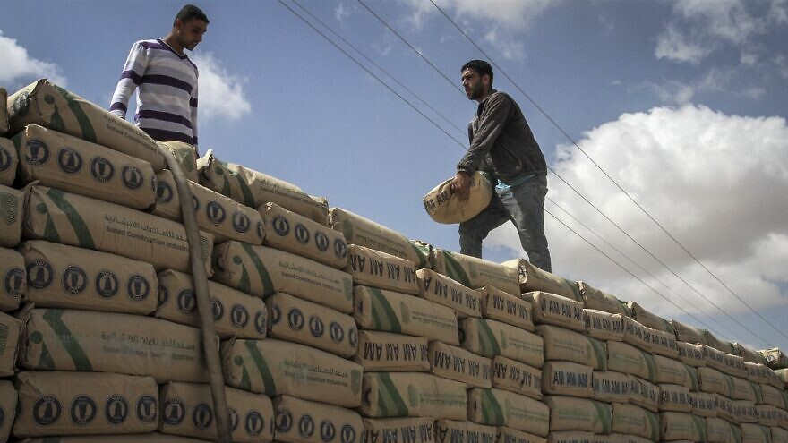 A Palestinian truck loaded with bags of cement after entering the southern Gaza Strip from Israel through the Kerem Shalom crossing in Rafah on May 23, 2016. Photo by Abed Rahim Khatib/ Flash90.