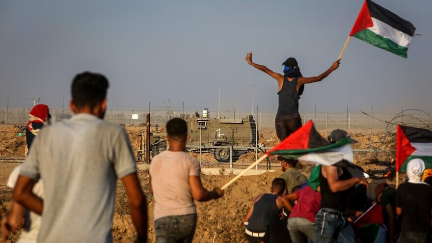 Palestinian protesters clash with Israeli forces at the Israel-Gaza border, east of Khan Yunis in the southern Gaza Strip, on Aug. 25, 2021. Photo by Abed Rahim Khatib/Flash90.