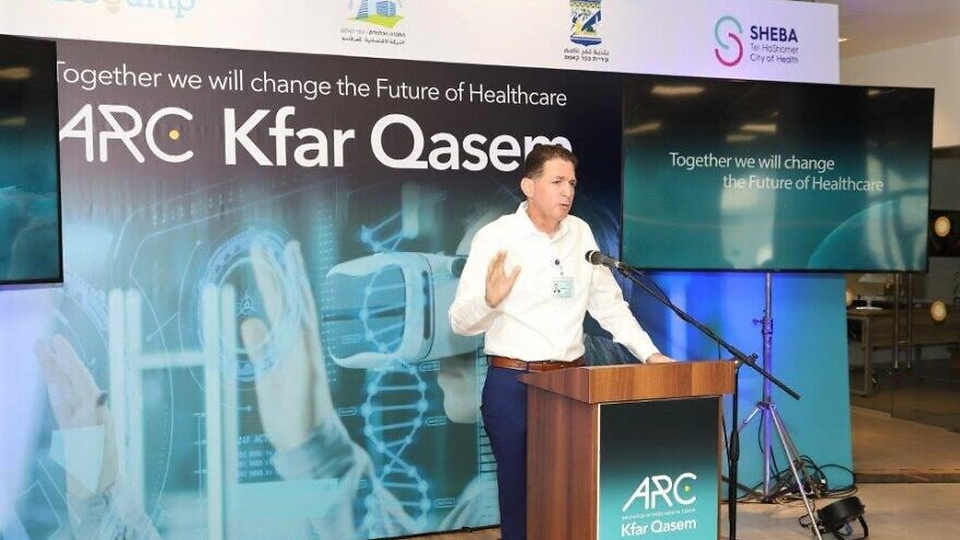 Sheba Medical Center launches the ARC startup ecosystem for the Israeli-Arab community in the city of Kfar Qasem at a ceremony attended by Knesset members, medical dignitaries and Kfar Qasem Mayor Adel Badir. At the podium is Professor Eyal Zimlichman, director and founder of ARC and chief medical & Innovation Officer at Sheba Medical Center, Aug. 17, 2021. Photo by Naama Frank Azriel.