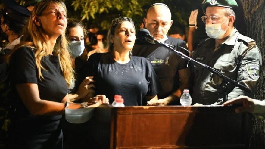 Nitza Shmueli (center) at the funeral of her son, Israel Border Police Sgt. Barel Hadaria Shmueli, who died on Aug. 30, 2021. Credit: Israel Border Police.