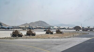 U.S. soldiers assigned to the 82nd Airborne Division patrol Hamid Karzai International Airport in Kabul, Afghanistan, Aug. 17, 2021. Credit: U.S. Central Command Public Affairs.