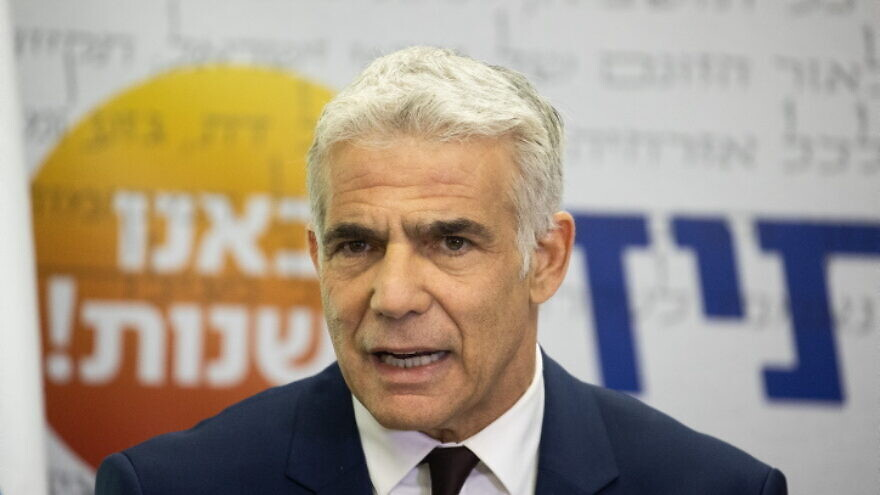 Israeli Foreign Minister Yair Lapid, seen here in the Knesset on July 26, 2021, blamed Poland for a recent deterioration in ties. Photo by Yonatan Sindel/Flash90