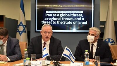 Israeli Defense Minister Benny Gantz and Foreign Minister Yair Lapid lead a briefing to ambassadors of U.N. Security Council member states on the threats Iran poses internationally on the seas and elsewhere, Aug. 4, 2021. Credit: Israel Ministry of Foreign Affairs.