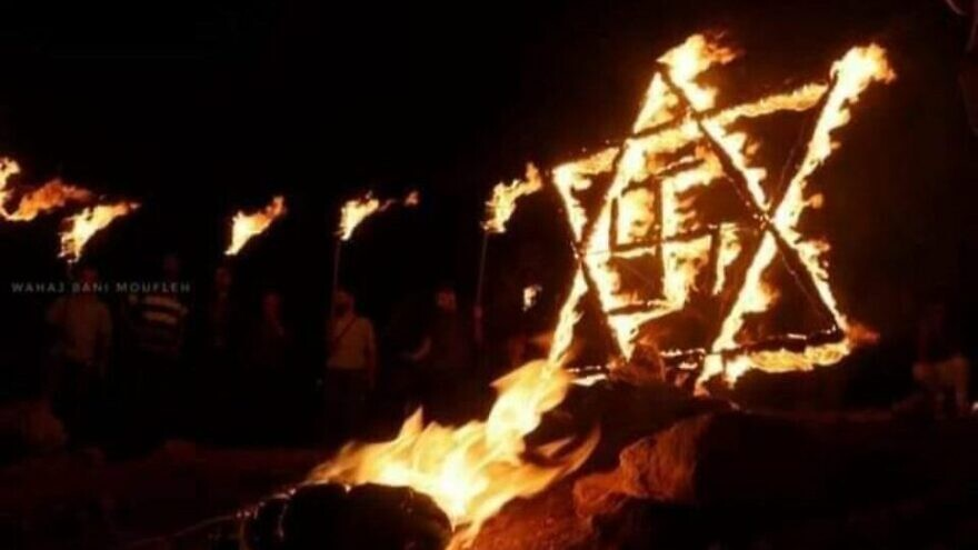 A burning swastika inside a Star of David, erected on Aug. 14, 2021 during riots in the village of Beita in Samaria. Source: Screenshot.