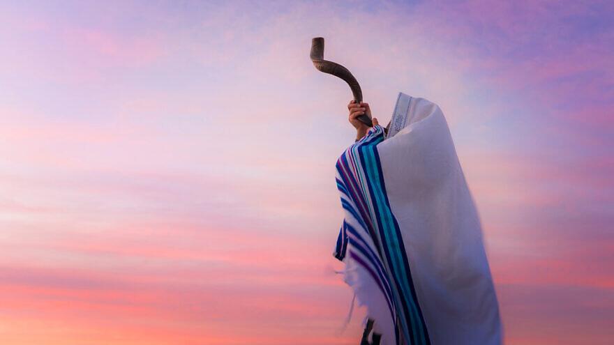 A man blowing a shofar. Credit: John Theodor/Shutterstock.