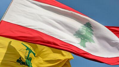 Flag of Hezbollah and Lebanon flying together. Credit: Arthur Sarradin