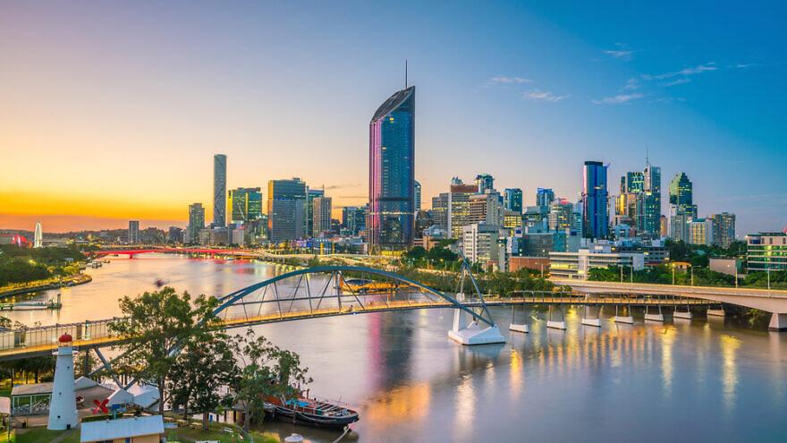 City skyline of Brisbane and the Brisbane River at twilight in Australia. Credit: Shutterstock.