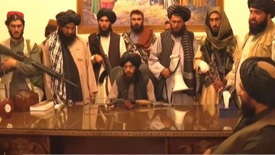 Taliban fighters inside the presidential palace in Kabul. Source: Screenshot.