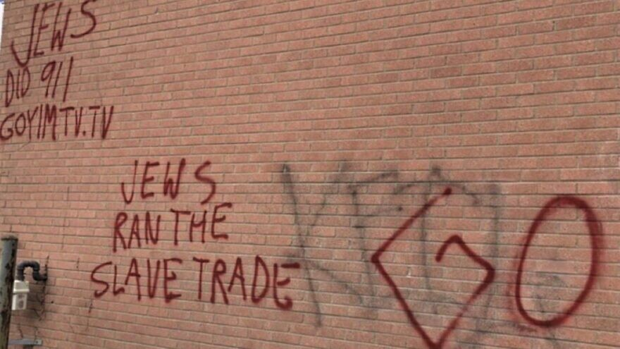 Graffiti claiming that Jews were responsible for the Sept. 11 terror attacks was painted on a building in Toronto (pictured) and a highway overpass in Canada, September 2021. Source: Screenshot.