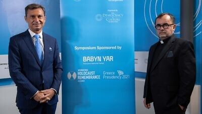 Achilles Tsaltas, president of the Democracy & Culture Foundation, with Father Patrick Desbois, head of the Babyn Yar Holocaust Memorial Center Academic Council, Sept. 30, 2021. Credit: Courtesy of the Athens Democracy Forum.