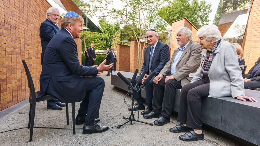 King Willem-Alexander of the Netherlands speaks with Holocaust survivors at the country's new Holocaust memorial in Amsterdam, Sept. 19, 2021. Source: Koninklijk Huis/Twitter.