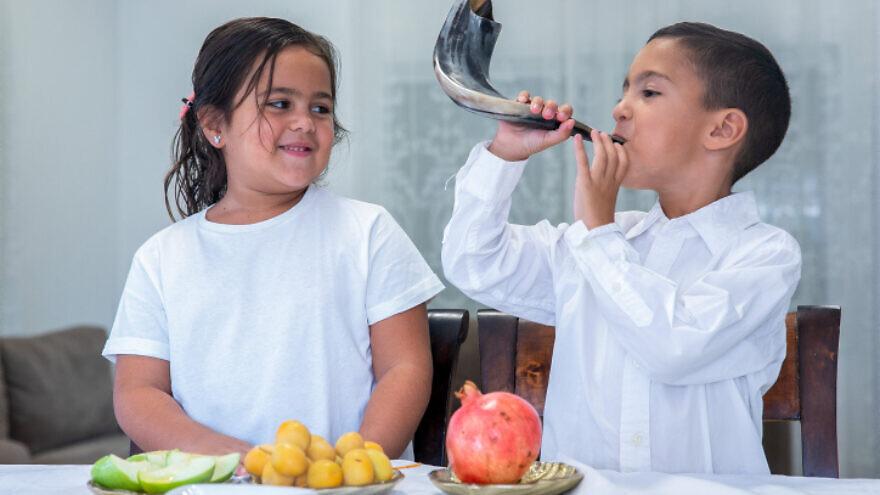 Kids prepare for the Jewish New Year at their home in Moshav Yashresh, Sept. 11, 2020. Photo by Yossi Aloni/Flash90.