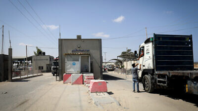 Palestinian trucks loaded with aggregate, iron and cement enter through the Kerem Shalom commercial crossing in the southern Gaza Strip, on Sept. 1, 2021. Photo by Abed Rahim Khatib/Flash90.