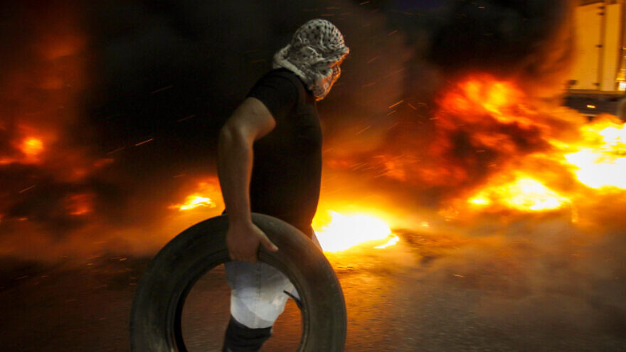 Palestinians demonstrate at the Israeli Hawara checkpoint near the city of Nablus and clash with Israeli security forces in support to the escape of the six Palestinian prisoners from the Israeli prison of Gilboa on Sept. 8, 2021. Photo by Nasser Ishtayeh/Flash90.