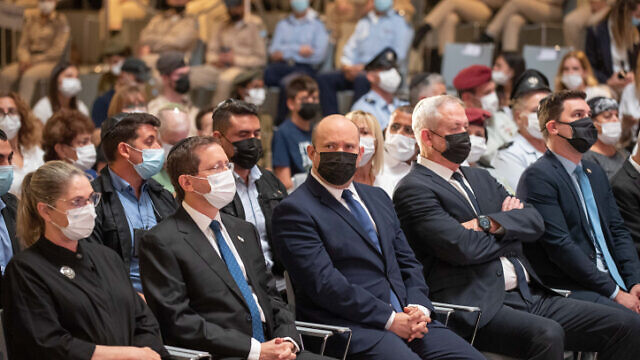 Israeli Prime Minister Naftali Bennett, President Isaac Herzog and Defense Minister Benny Gantz attend a memorial ceremony for the soldiers who fell in Israel's 1973 Yom Kippur war, at the National Hall of Remembrance, Mount Herzl, Jerusalem. Sept. 19, 2021. Photo by Ohad Zwigenberg/POOL.
