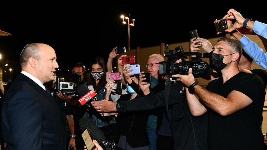 Israeli Prime Minister Naftali Bennett addresses reporters before boarding a plane to New York to address the U.N. General Assembly, Sept. 25, 2021. Photo by Avi Ohayon/GPO.