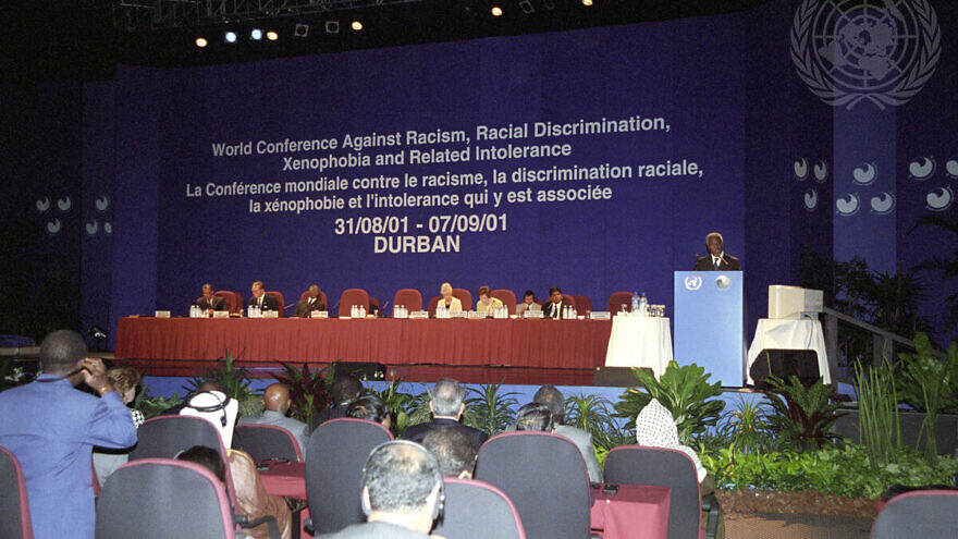 Secretary-General Kofi Annan (right at podium) speaking at the opening of the World Conference Against Racism, Racial Discrimination, Xenophobia and Related Intolerance in Durban. Credit: UN Photo/Evan Schneider.