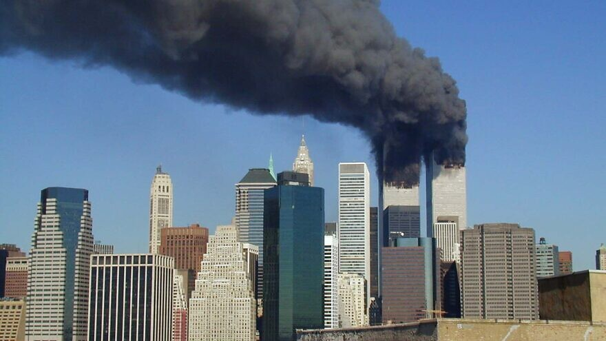 A view of the twin towers of the World Trade Center in New York City on fire after hijacked planes flew into the buildings on the morning of Sept. 11, 2001. Credit: Wikimedia Commons.