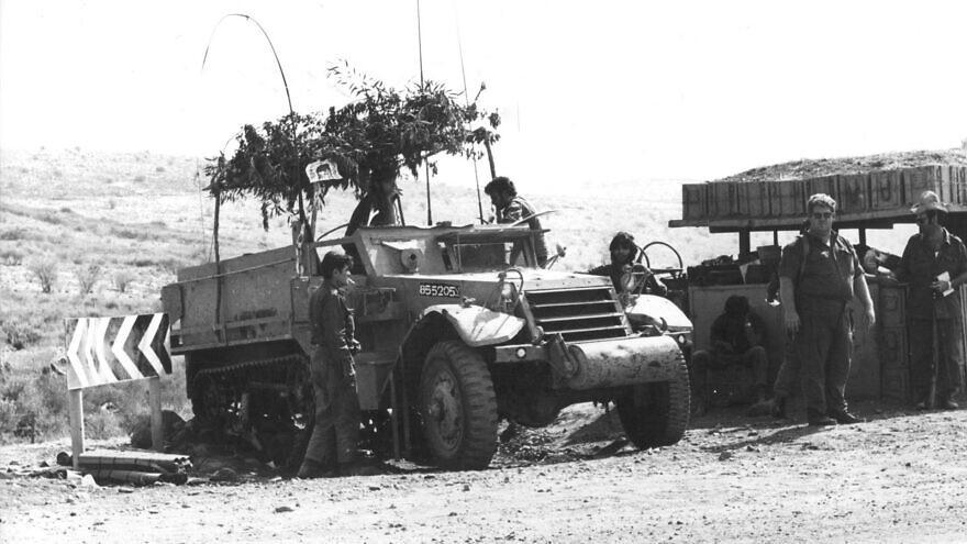 A sukkah on an Israeli army vehicle in the Golan during the 1973 Yom Kippur War. Photo by Nathan Fendrich, Courtesy of the Pritzker Family National Photography Collection at National Library of Israel.