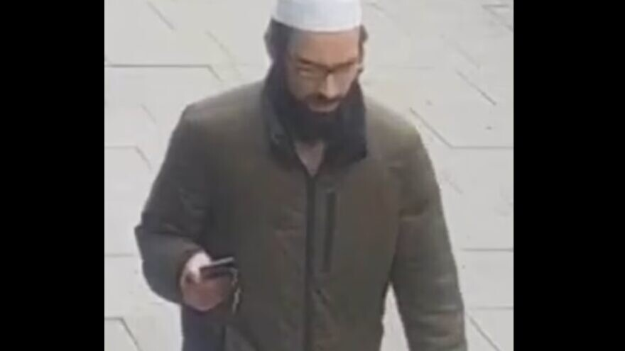 Surveillance camera images of a man that police want to identify in connection to a series of assaults on Jewish men that took place in North London. Source: Screenshot.