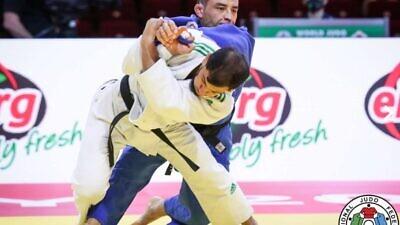 Algerian judoka Fethi Nourine (blue) competing in 2021. Credit: International Judo Federation.