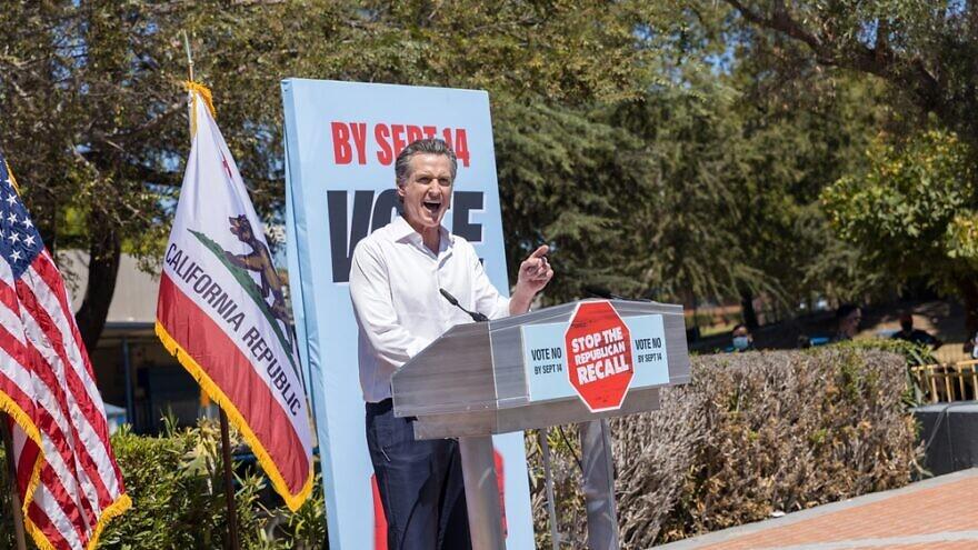 California Gov. Gavin Newsom speaks at his recall election rally at Culver City High School in Culver City, Calif., September 2021. Credit: Max Elram/Shutterstock.
