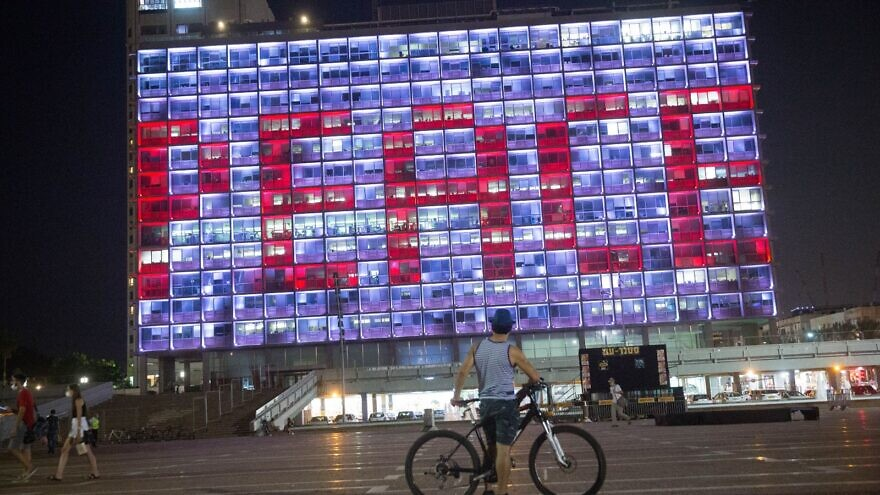 """Tel Aviv City Hall lights up with the word """"Peace"""" following the signing of the Abraham Accords, Sept. 15, 2020. Photo by Miriam Alster/Flash90."""