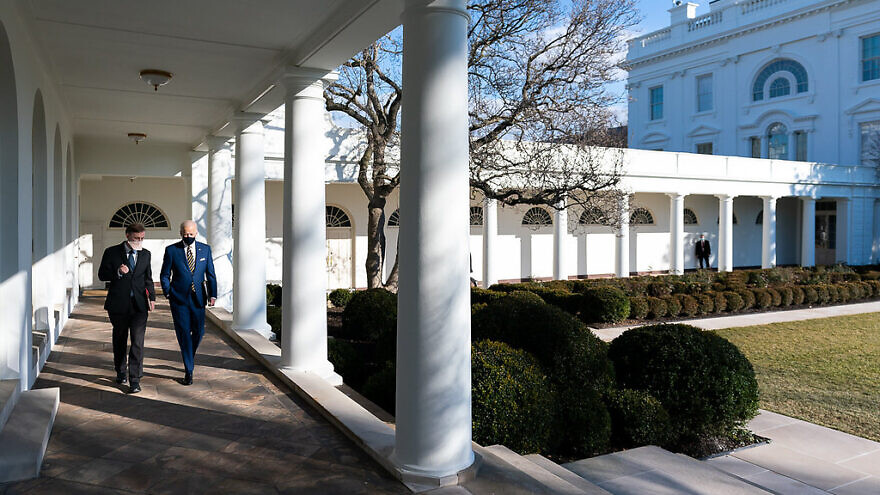 U.S. President Joe Biden walks with National Security Adviser Jake Sullivan along the Colonnade of the White House to the Oval Office on Jan. 22, 2021. Credit: Official White House Photo by Adam Schultz.