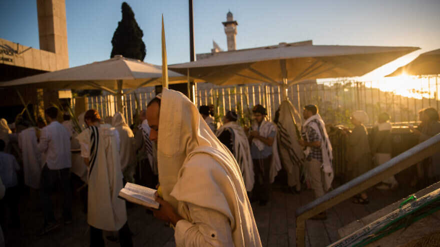 Jewish men pray at the entrance to the Temple Mount complex in Jerusalem on the holiday of Hoshana Raba, Oct. 11, 2017. Photo by Yonatan Sindel/Flash90.