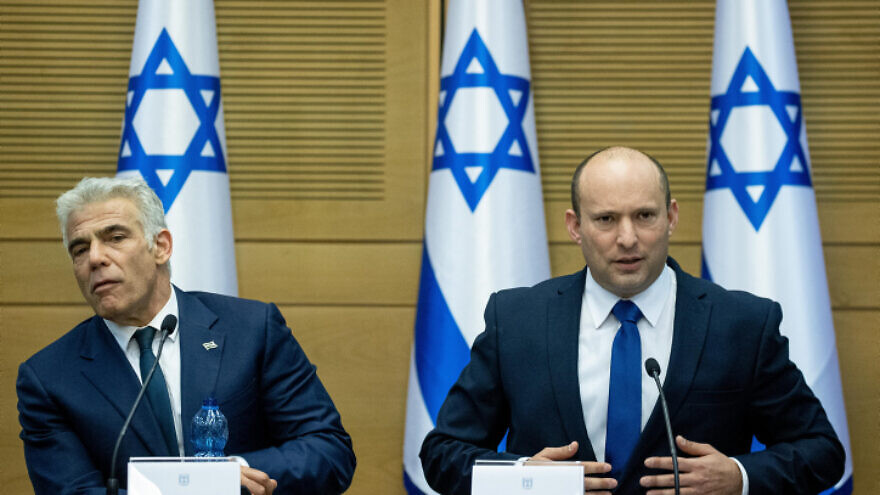 Israeli Prime Minister Naftali Bennett and Foreign Minister Yair Lapid at the Knesset, on June 13, 2021. Photo by Yonatan Sindel/Flash90.