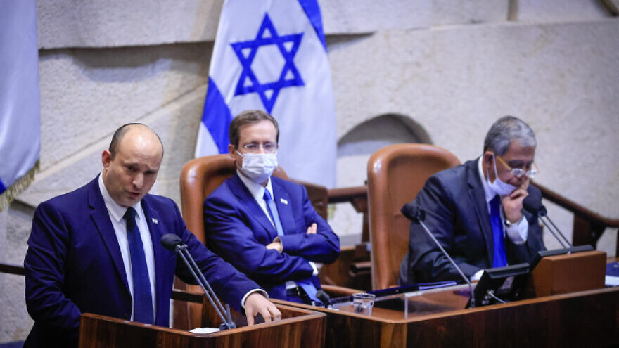 Israeli Prime Minister Naftali Bennett (with President Isaac Herzog and Knesset Speaker Miki Levy next to him) addresses the opening of the Knesset's winter session, Oct. 4, 2021. Photo by Olivier Fitoussi/Flash90.