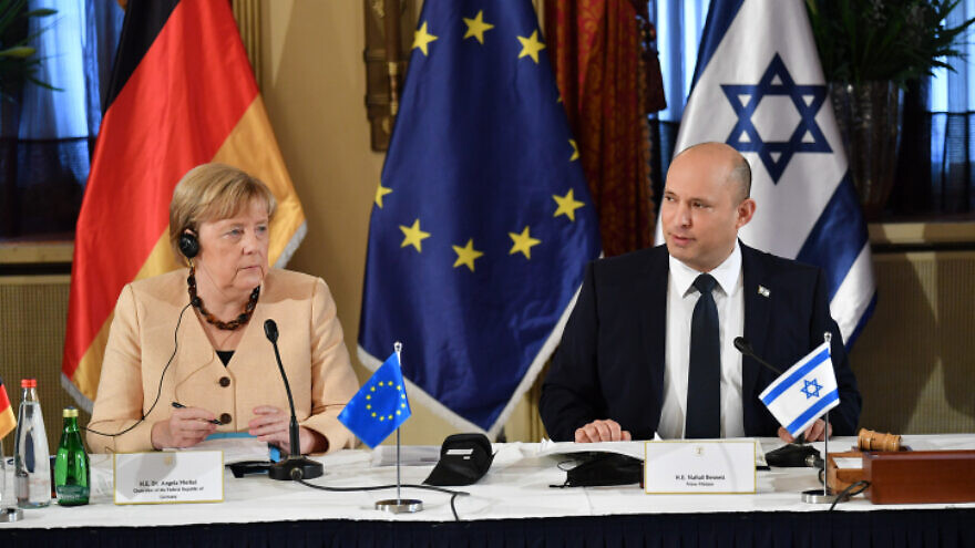 German Chancellor Angela Merkel with Israeli Prime Minister Naftali Bennett at a special Cabinet session at the King David Hotel in Jerusalem, Oct. 10, 2021. Photo by Yoav Dudkevitch/POOL.