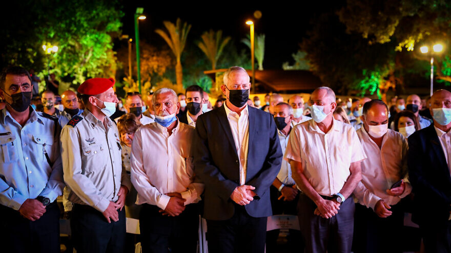 """Israeli Defense Minister Benny Gantz and officers of the Israel Defense Forces during a """"Brotherly Covenant"""" ceremony held at the Memorial Monument to the Bedouin Warriors in northern Israel, Oct. 6, 2021. Photo by Alon Nadav/Flash90."""