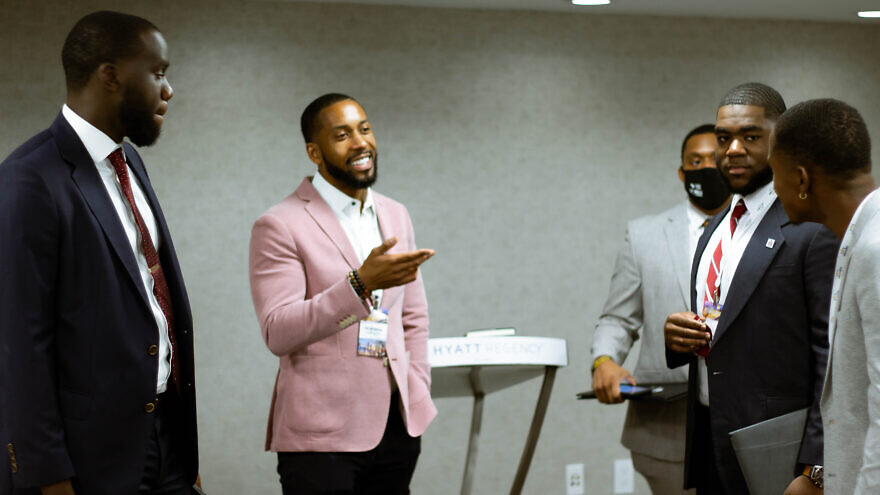 Marvel Joseph (left), MTF coalitions coordinator, and Jonathan Quarles (right), Founder & CEO of The BTL Group, speak with students at the Black Student Leaders Summit.  (Photo credit: Christopher François)