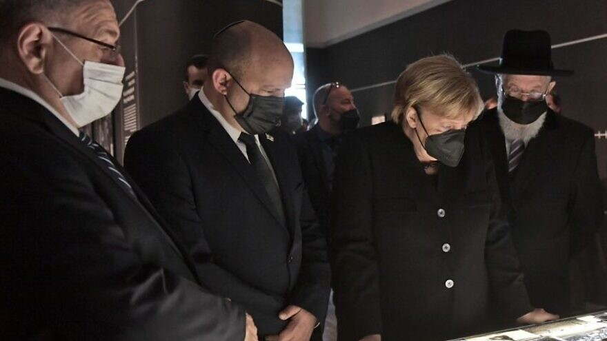 German Chancellor Angela Merkel (second from right) visits Yad Vashem, Oct. 10, 2021. Photo by Koby Gideon/GPO.