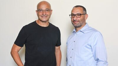 Yossi Carmil Cellebrite CEO (left) and Yossi Ofek, chairman and CEO at Digital Clues. Photo by Shay Shviro.