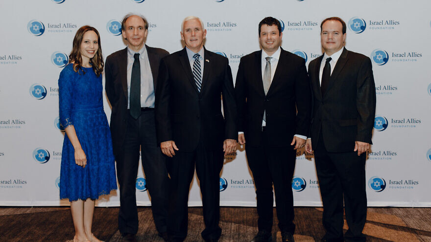 Israel Allies Foundation staff with Gilad Erdan and Mike Pence. Credit: Israel Allies Foundation.
